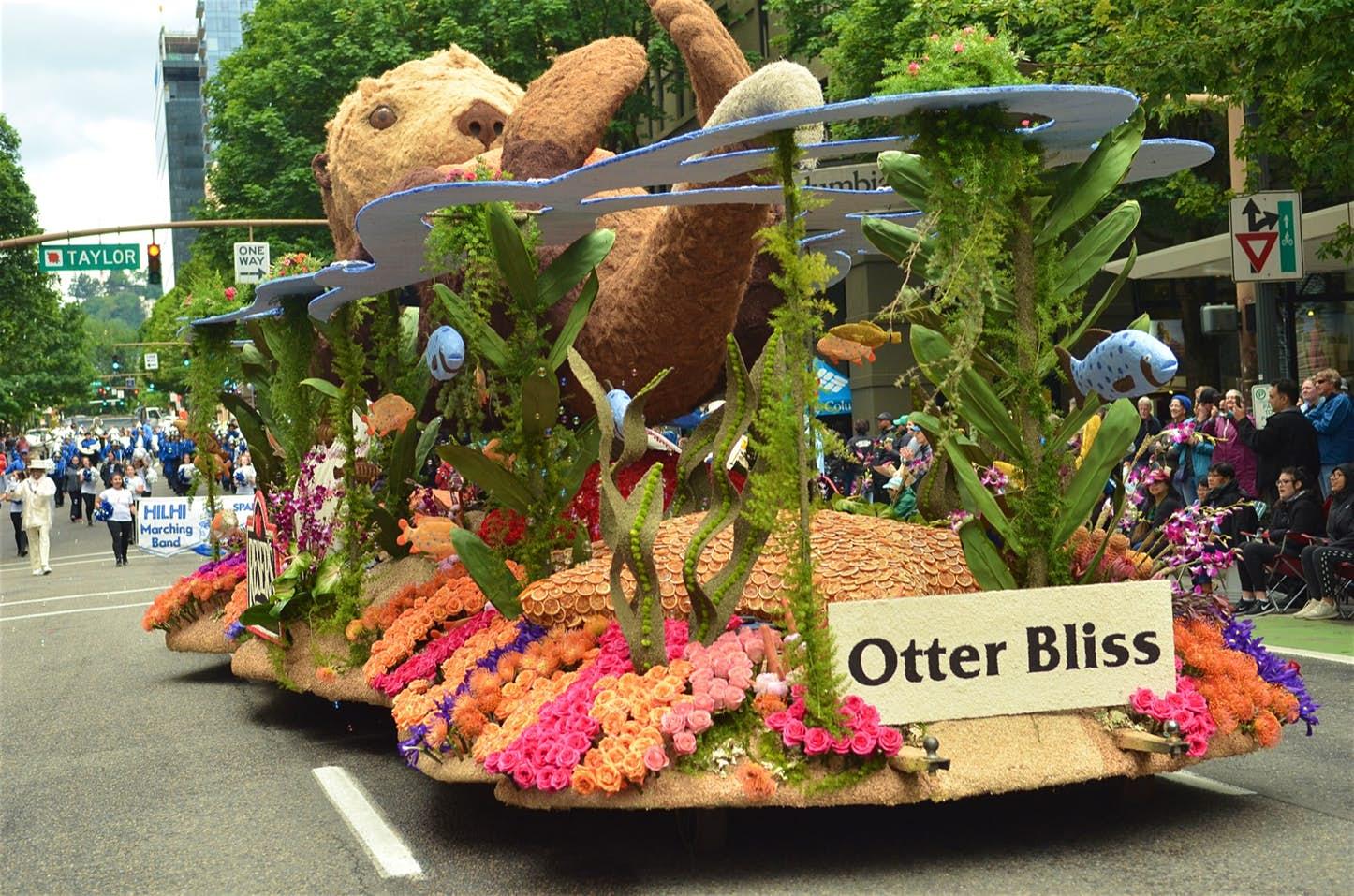 "Rose flower float with sign ""Otter Bliss"""