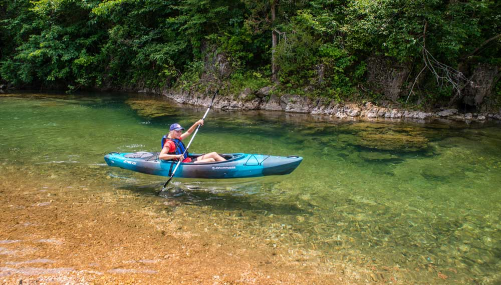 a kyak in crystal clear water at Echo-Bluff State Park, Missouri