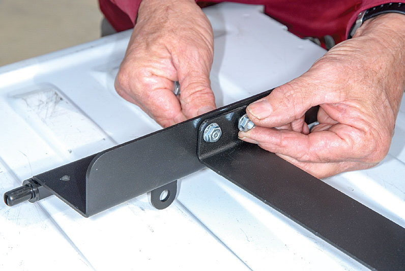 1) The first step in the installation is to assemble the brackets for mounting on the side wall of the truck bed.