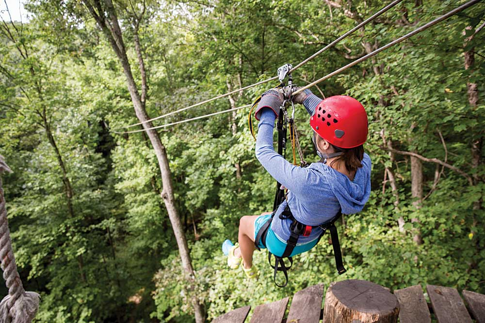 A zip-liner descends through Mohican State Park in Ohio