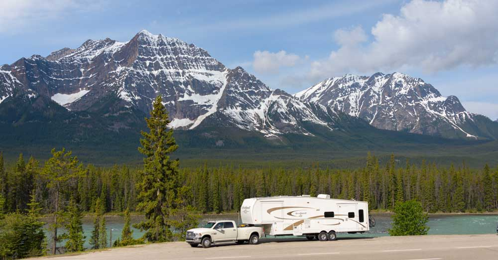 The authors' fifth-wheel trailer and truck parked along the Icefields Parkway with a Canadian Rockies backdrop