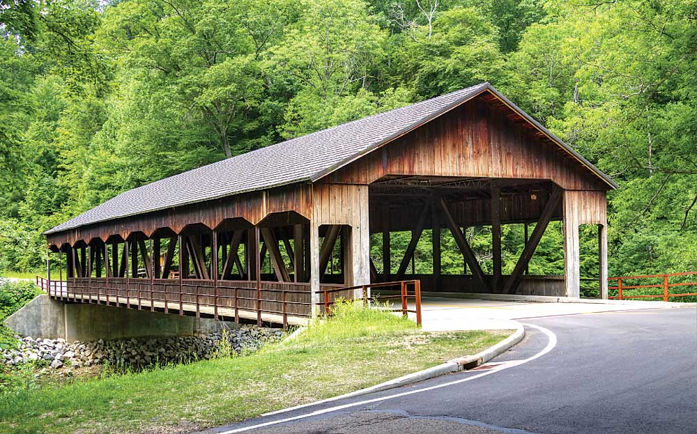 the Mohican State Park covered bridge spans the Clear Fork of the Mohican State Scenic River.