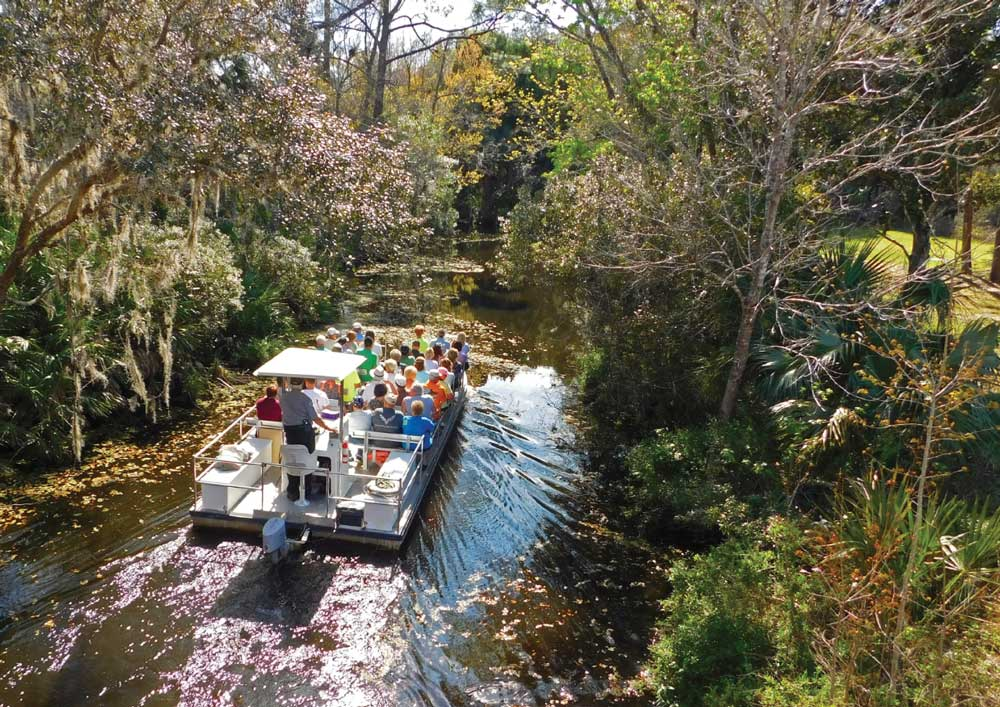 Visitors on a sightseeing boat take in the view on the Homosassa River at Florida's Ellie Schiller Homosassa Springs Wildlife State Park