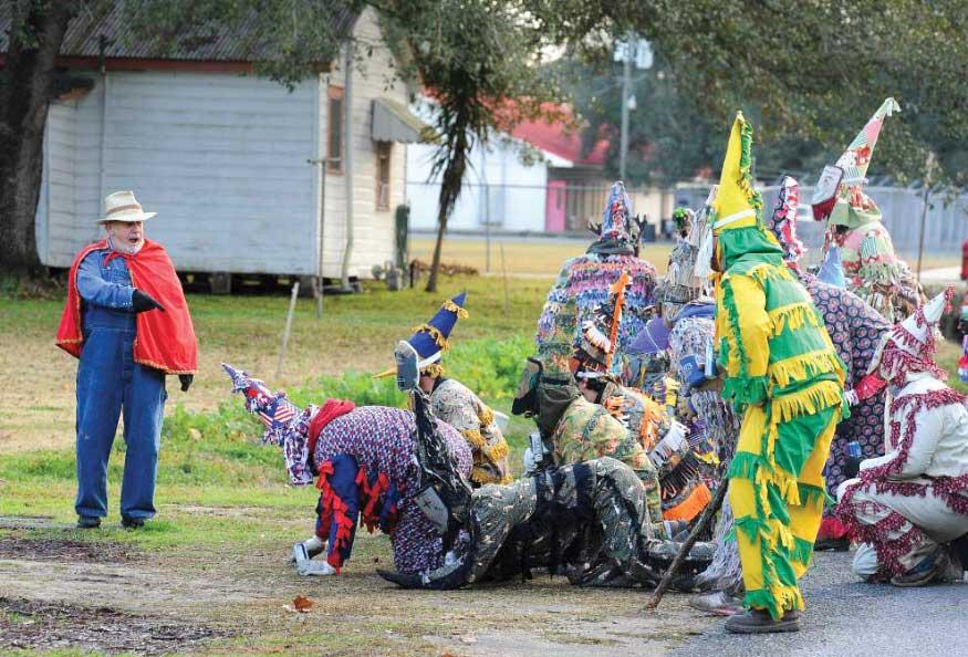costumed locals engage in Mardi Gras street performance in Evangeline Parish, Louisiana