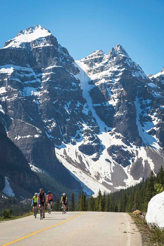 Bicyclists on the road to Moraine Lake in the Canadian Rockies