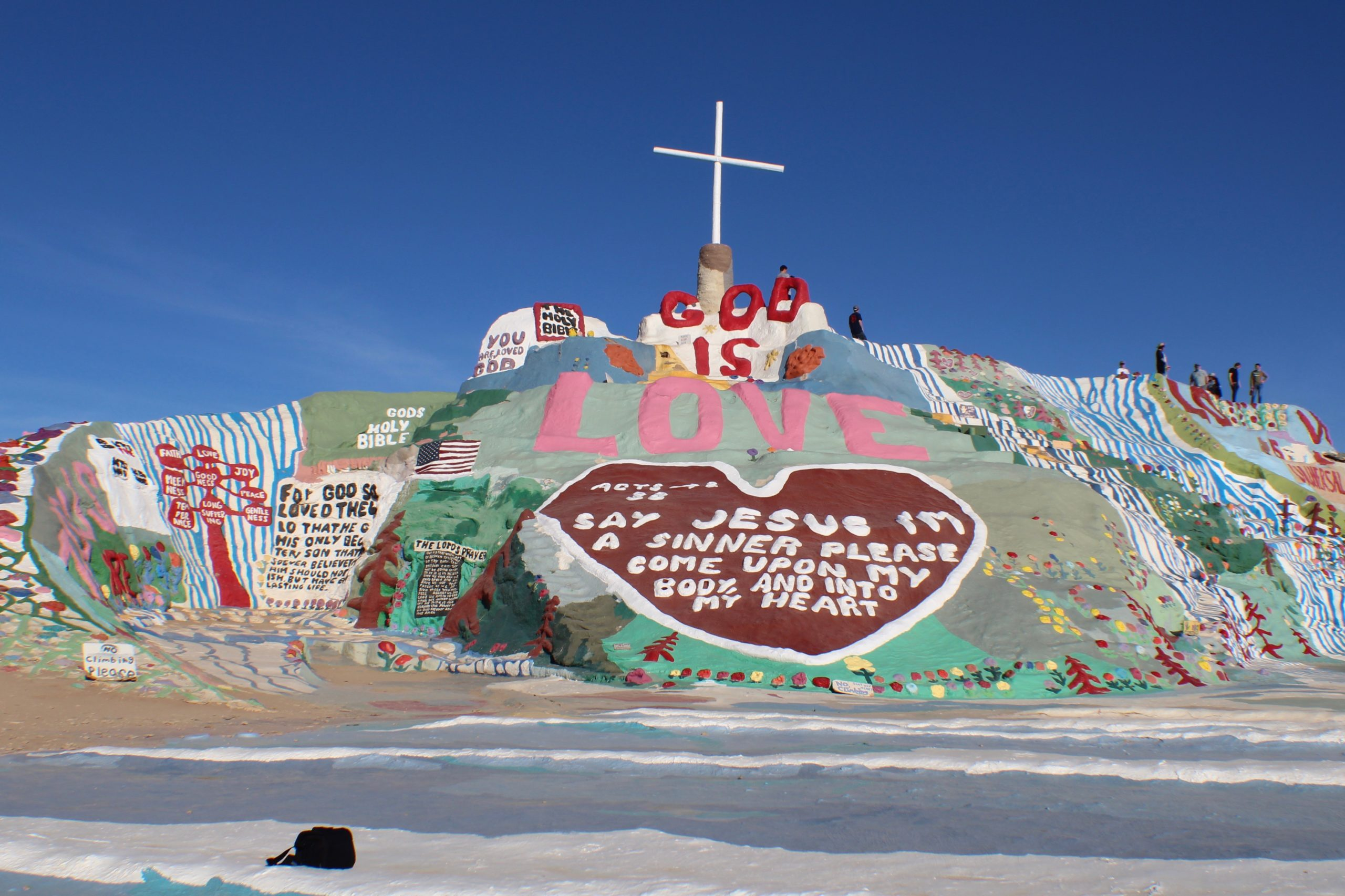 Salvation Mountain displaying biblical messages and cross