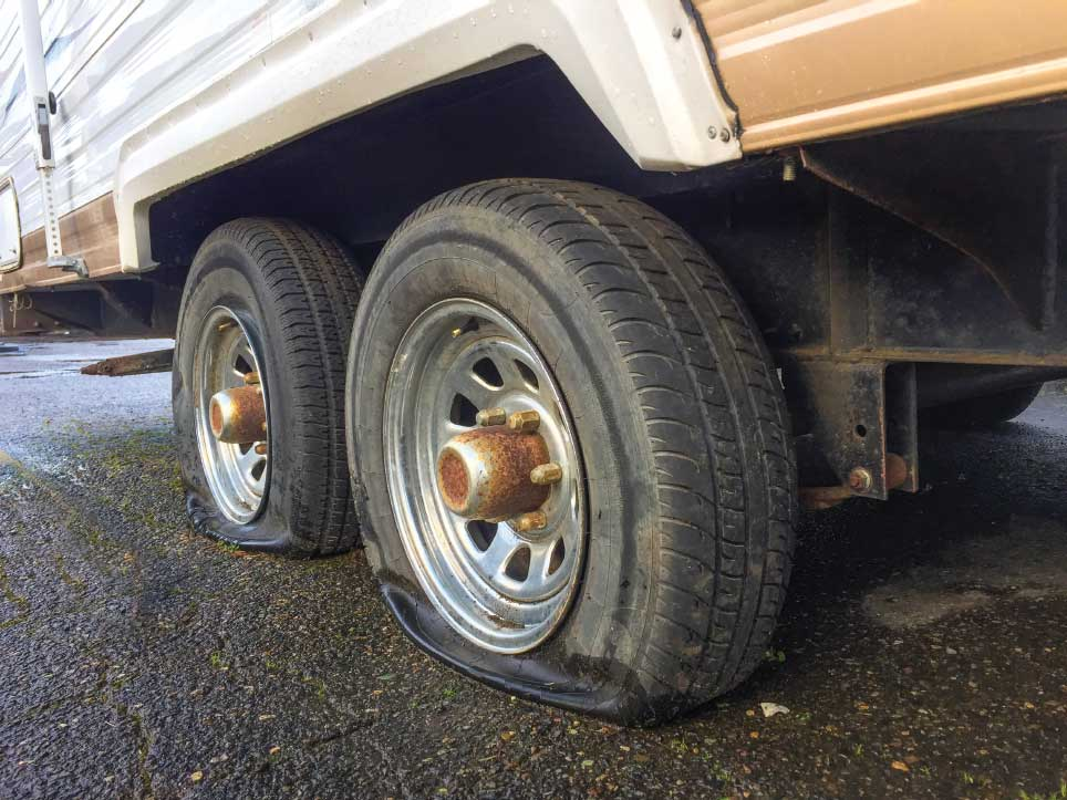 Right: Some TPMS applications monitor trailer tires even when the trailer is not attached to the tow vehicle, which can prevent tire damage caused by the trailer sitting on the rims.