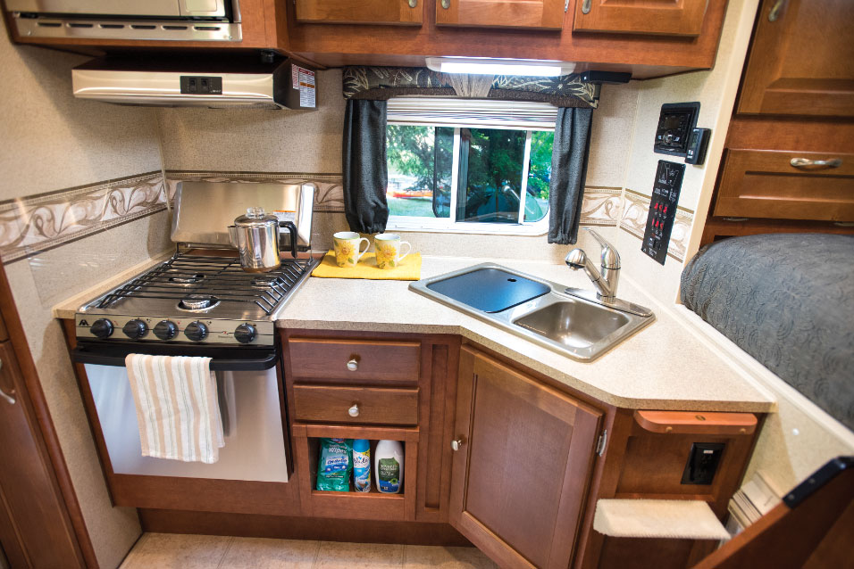 The galley is nicely appointed with a three-burner gas range and ample counter space.