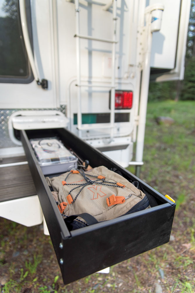 A 5-foot storage drawer extends under the floor and can hold fishing rods or other long items.