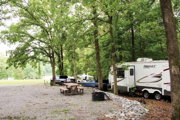 RVs parked in forest at Hillman Ferry Campground in Land Between the Lakes, Tennessee