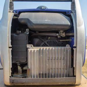 To access the air filter, unscrew and remove the side panel of the generator.