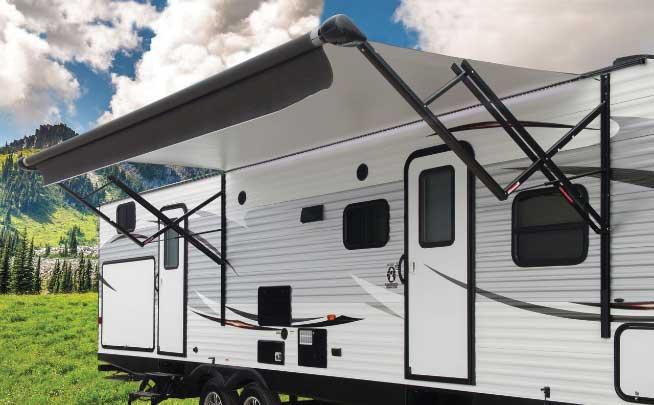 RV Awning extended outside travel trailer