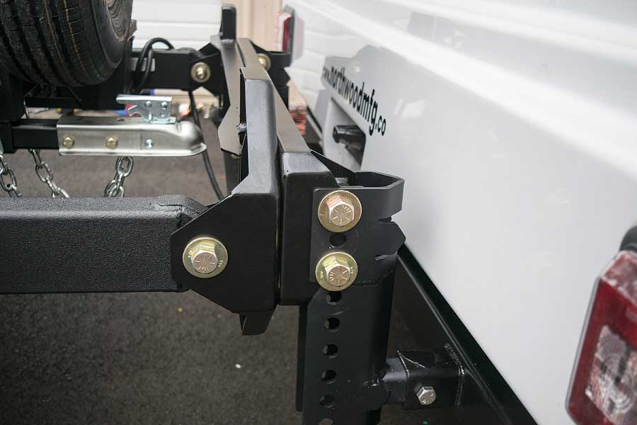 Photo shows the mount arms are bolted to the receiver, and the tote is bolted to the mounts.