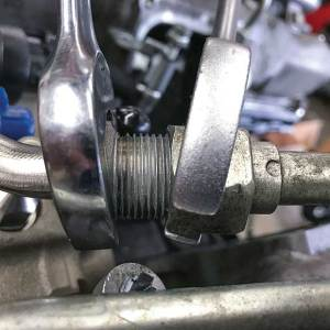 The OEM low-pressure fuel-feed supply line in the valley is replaced with a shorter one that comes with the S&S Diesel kit.