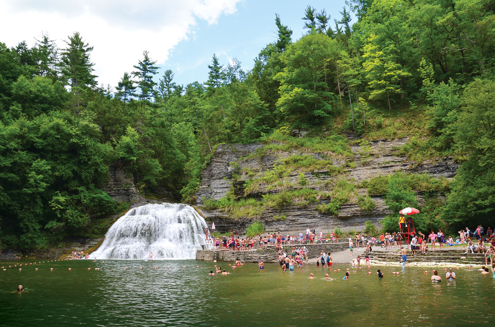 Robert H. Treman State Park's mountain pool provides a unique opportunity for swimming at the base of thundering waterfalls.
