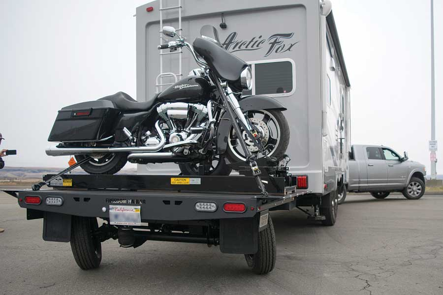 Photo shows the self-steering axle in operation on a loaded Freedom Hauler.