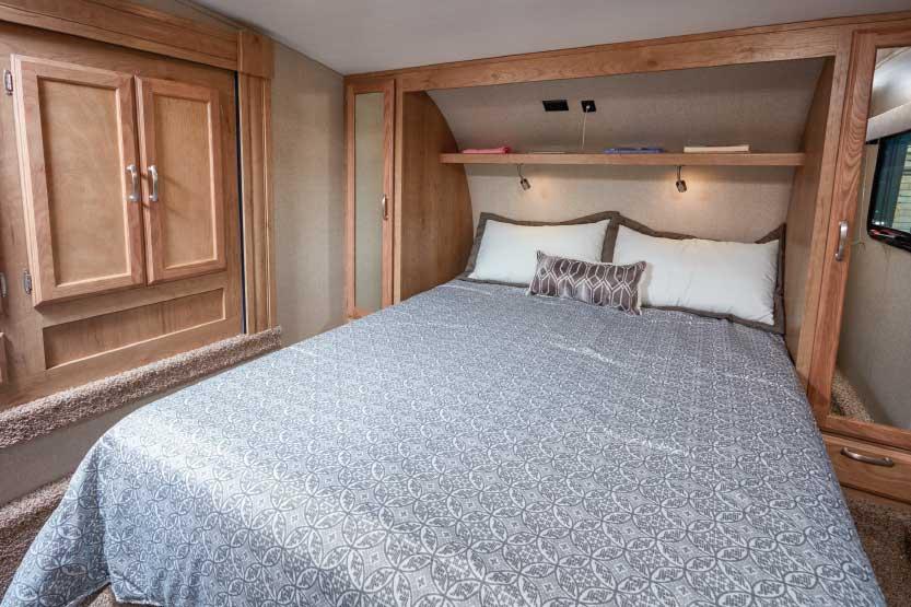 Photo of Winnebago Minnie Plus 29RBH fifth wheel trailer interior, bedroom area