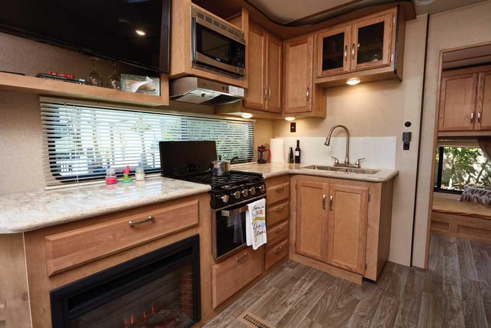 Photo of Winnebago Minnie Plus 29RBH fifth wheel trailer interior, galley area