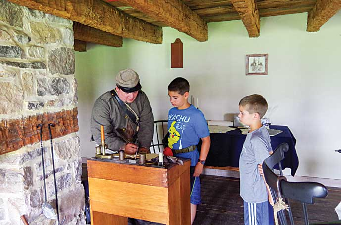 Writing with a quill pen at Fort Frederick.