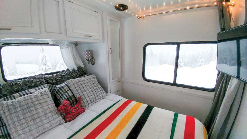 White woodwork and bold stripes make the Wagners' bedroom cheerful, even on cold winter days.