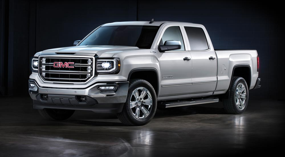 Silver GMC shiny truck with tinted windows