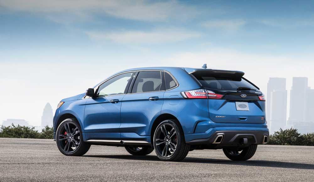 A blue Ford edge in an urban setting