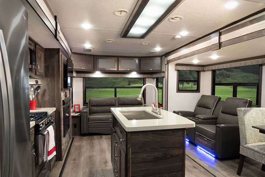 Looking toward back couch and window in Open Range 322RLS travel trailer