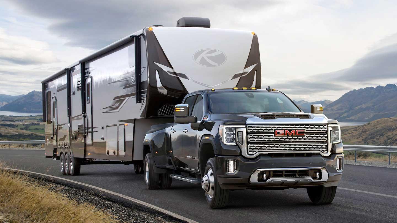 Dark colored heavy duty pickup towing a Keystone fifth-wheel trailer