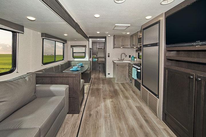 Living area and kitchen of 2021 Starcraft Super Lite 281BH travel trailer