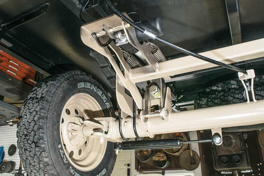 Photo shows the electric actuator that rotates the steering axle into a forward or reverse position.