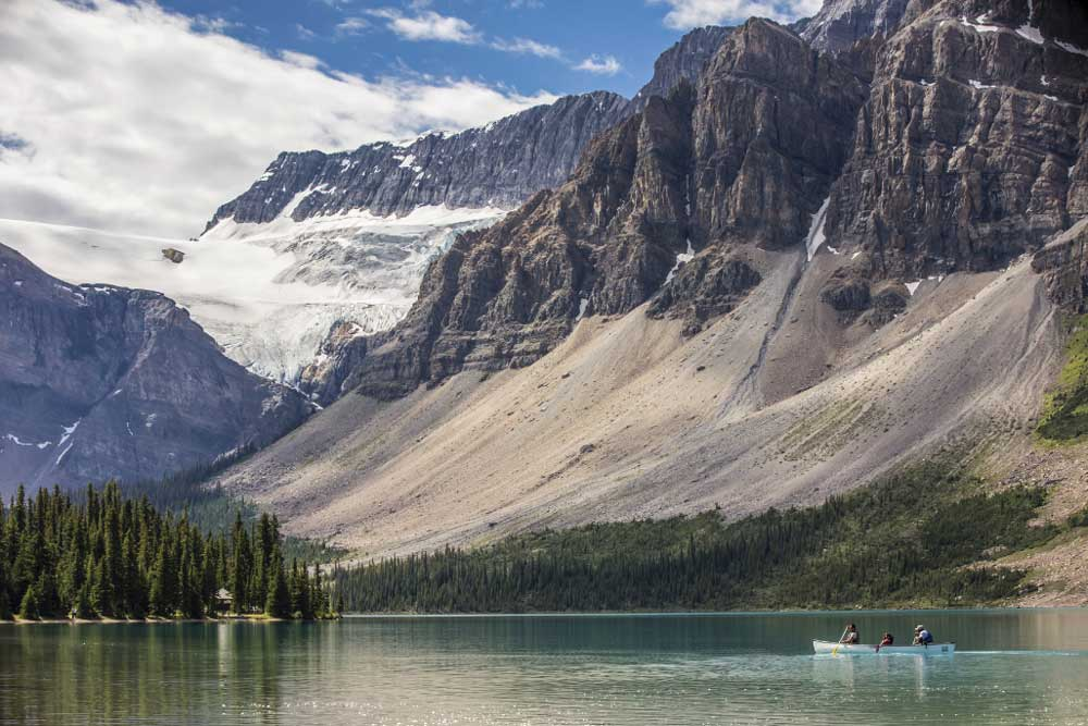 On the province's western side, the Bow River flows into turquoise- blue Bow Lake, presenting stunning photo opportunities just off the Icefields Parkway.