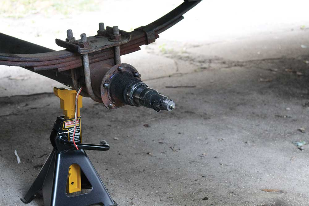 The brake wires on the right side of the trailer are routed through the axle tubes.
