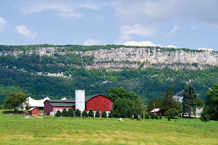 The Shawangunk Mountains rise up behind a Hudson River Valley farm.
