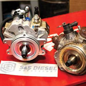 Photo showing that the CP3 high-pressure fuel-injection pump (left) is slightly larger bodied than the factory CP4.2 found on the 2011 to 2016 Duramax LML.