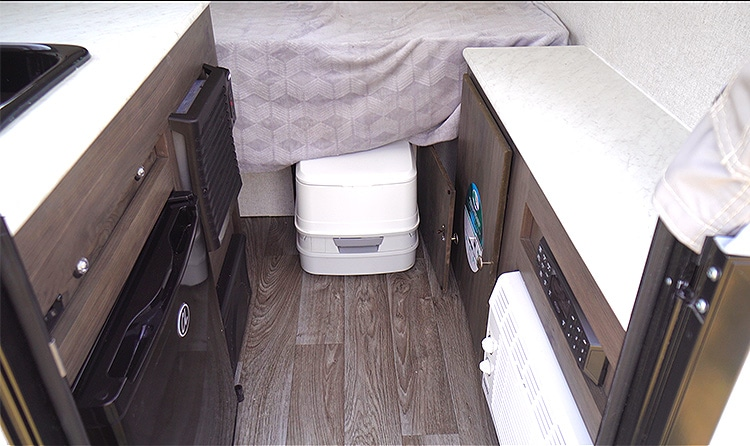 View inside showing the slide-in portable toilet.