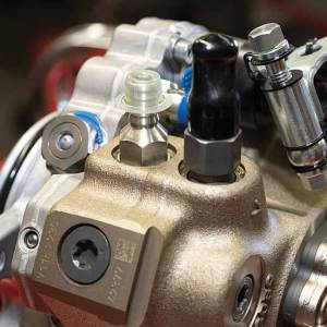 """Photo showing how S&S Diesel's engineers made multiple internal and external modifications to the factory CP3 pump so it would match the fuel-flow requirements of the LML Duramax's piezoelectric injectors and work seamlessly with the factory EGR system, including the """"ninth injector."""""""