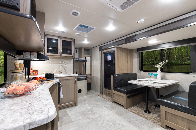 Looking toward the rear of the trailer toward the bunks, showing the kitchen and dinette.
