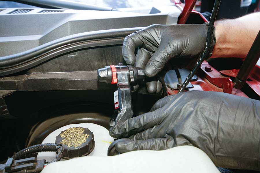 A technician rotates the rings from the 12- to the 5-o'clock position, locking the harness and terminator cap to the tuner.