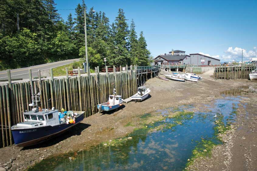 In Nova Scotia, on the shores of the Bay of Fundy, low tide strands fishing vessels in the picturesque community of Hall's Harbour.