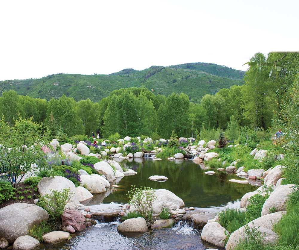 Set on the banks of the Roaring Fork River, the John Denver Sanctuary is lush with flowers.