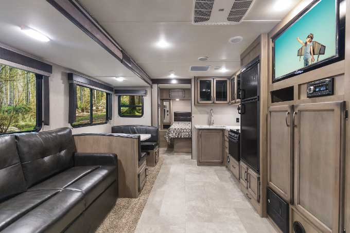 """Production on the 32-foot Transcend 27BHS, Grand Design RV's first """"stick-and-tin"""" travel trailer, starts this spring."""