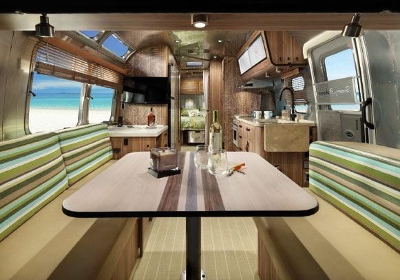 Interior trailer kitchen with ocean view through window