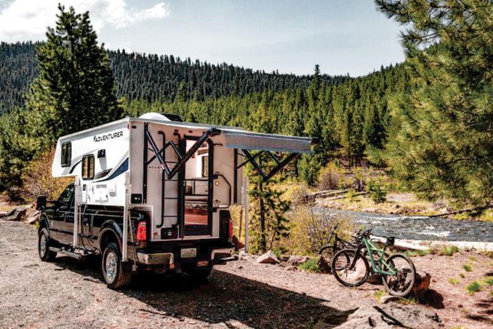 Adventurer 80RB slide-in camper by river
