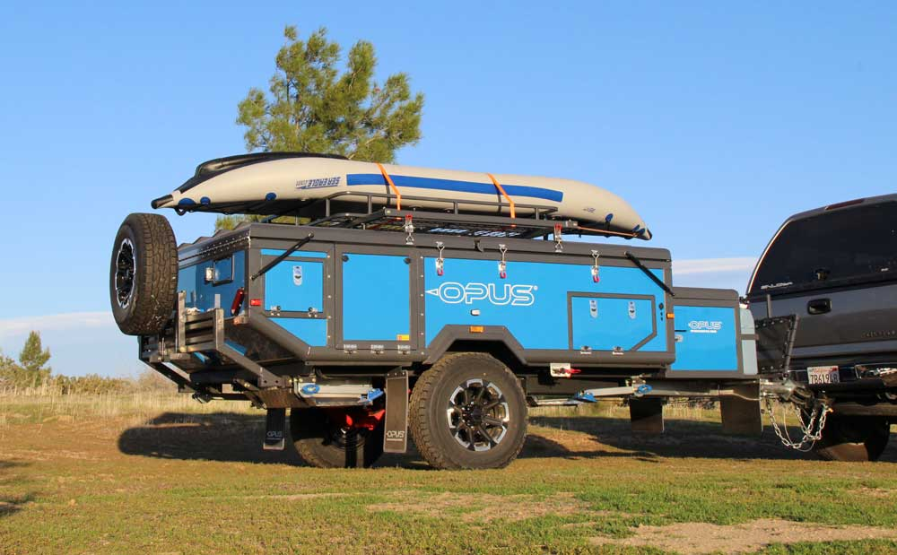 Inflateable kayak on the roof rack of an Air Opus trailer
