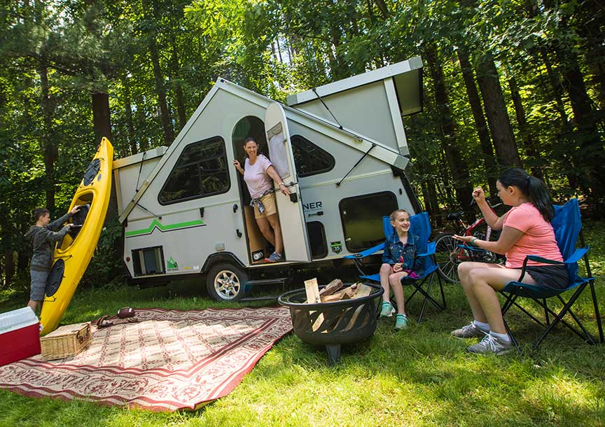 Aliner Expedition trailer with family at campsite