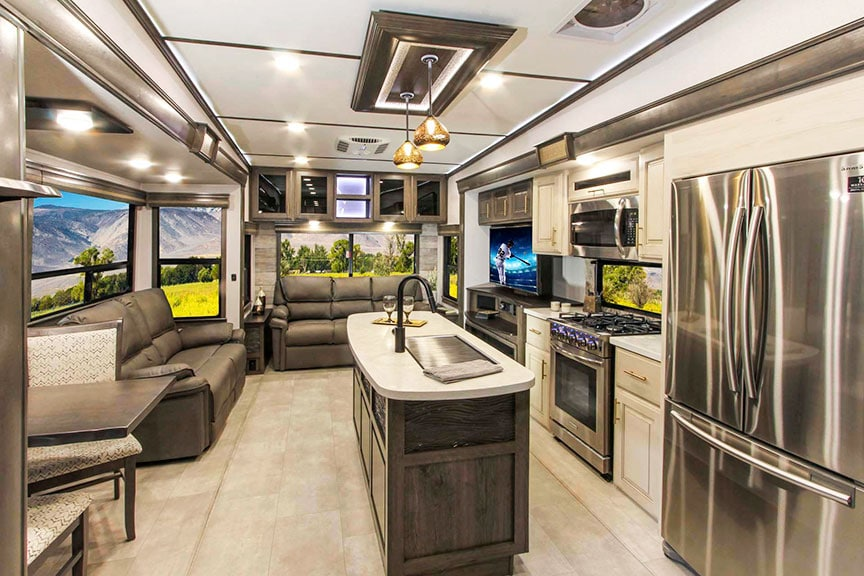 Inside Paradigm 370FB fifth-wheel looking toward kitchen and living area