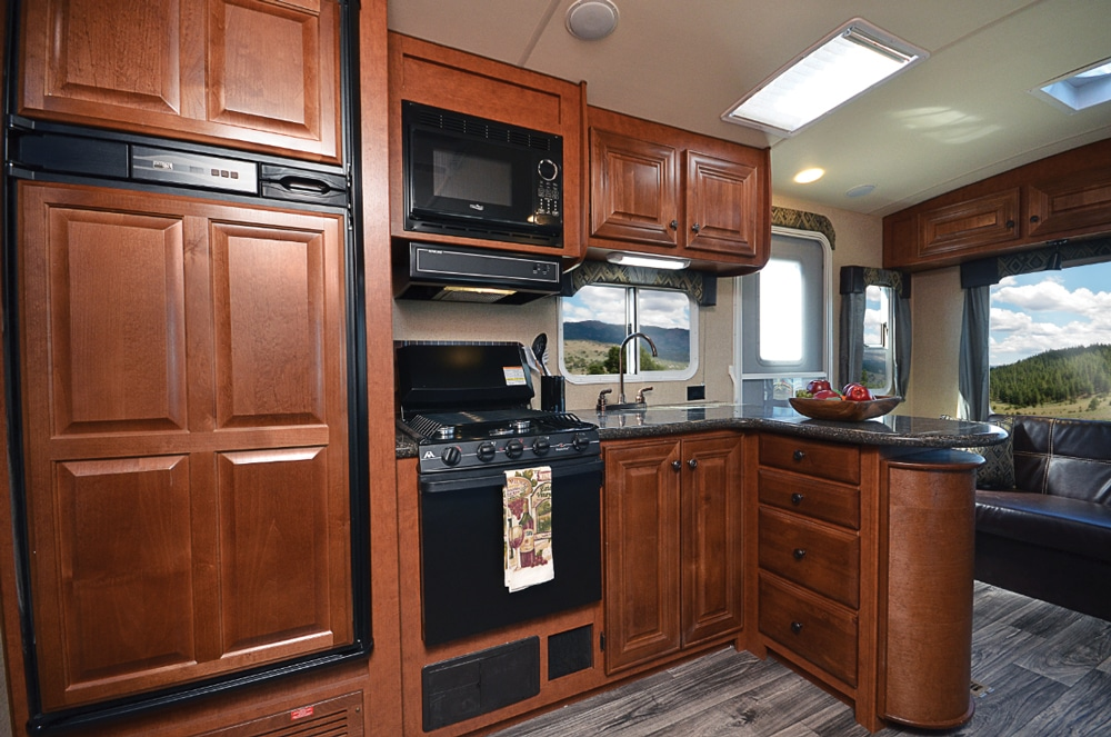 Although the microwave is small, the 10-cubic-foot refrigerator-freezer, three-burner range and dual sink make up for it.