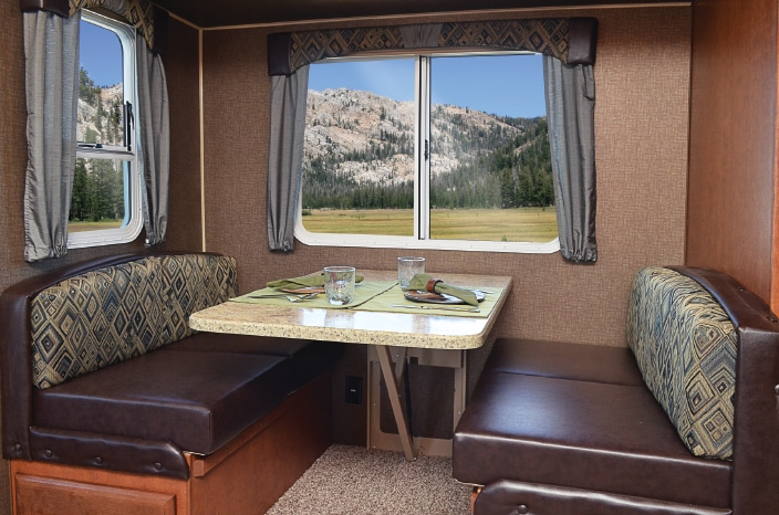 The convertible dinette in the slideout maximizes living space and allows for ease of conversation between the sofa and galley.