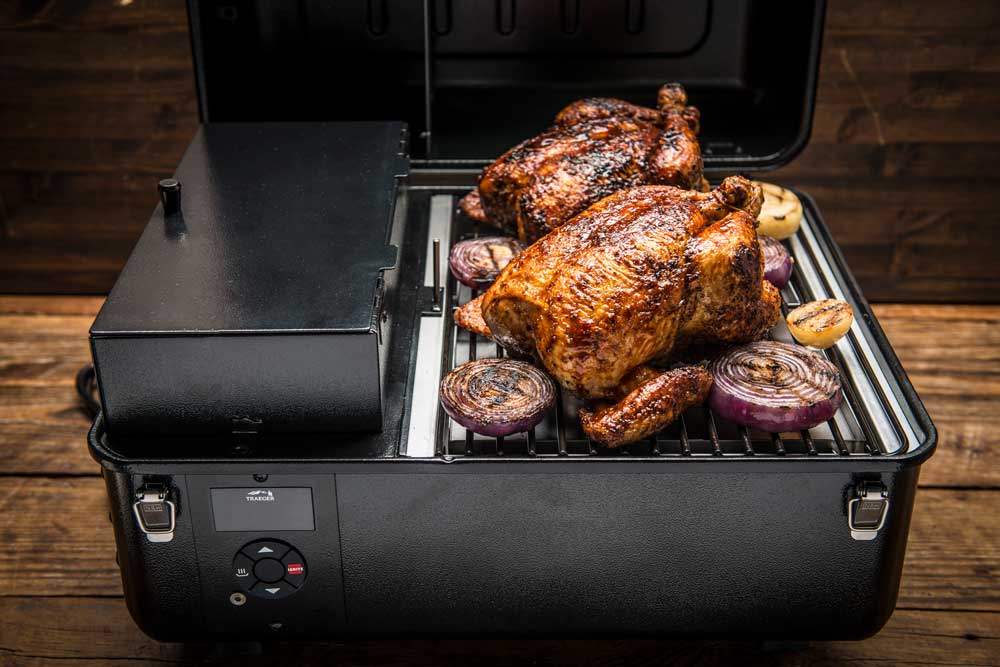 Roast Chicken and red onions on a Traeger Ranger grill