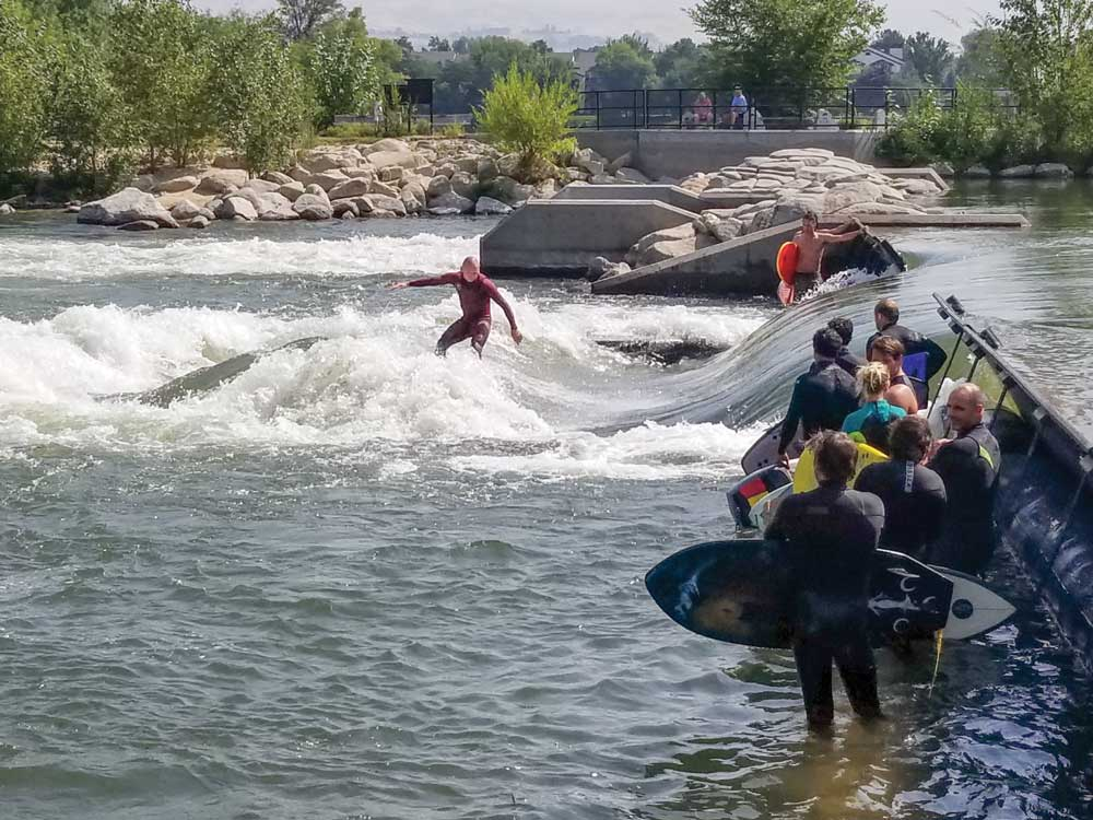 Surfers wait in line at the J.A. and Kathryn Albertson Family Foundation Boise Whitewater Park to ride the Green Wave.